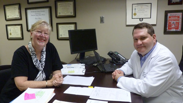 Phoebe Robinson discussing recovery from her right renal aneurysm repair surgery with vascular surgeon Dr. Steve Taylor in his office at Shelby Baptist. (contributed)