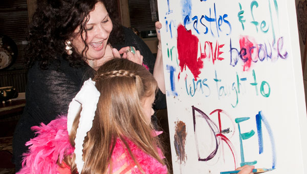 Laurie Kramer, an artist and teacher now living in Helena, has also worked as a teaching artist with the Cultural Alliance program. Here she and her Art-Partner, Grace Davis, approach the end of a recent painting session. (contributed)