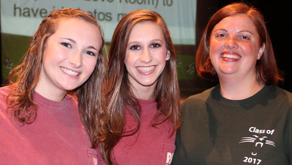Senior peer helpers Bailey Stephens and Olivia King join faculty sponsor Missy Copes as they usher freshmen in to begin Camp Pelham welcoming the class of 2017. (Contributed)