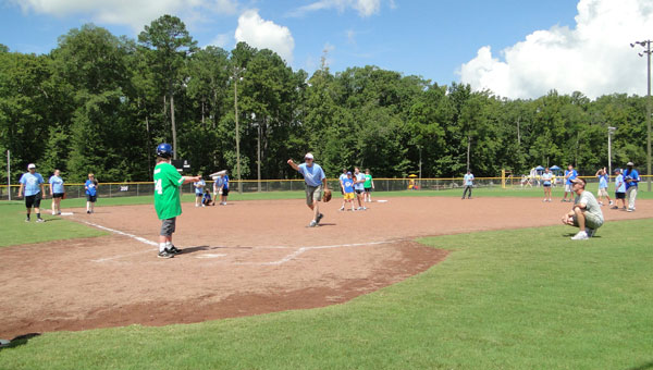 Jeffrey Palmer swings at a ball at the Field of Angels opening day game held Aug. 10 at Oliver Park. (contributed)