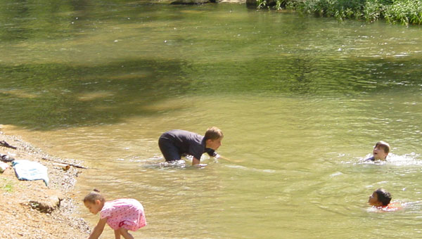 Children enjoy the waters of Shoal Creek. (contributed)