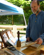 Christopher Lang, who will speak at the Columbiana Public Library on Aug. 29, is shown demonstrating traditional woodworking skills and discussing early hand tools at a recent festival. (contributed)