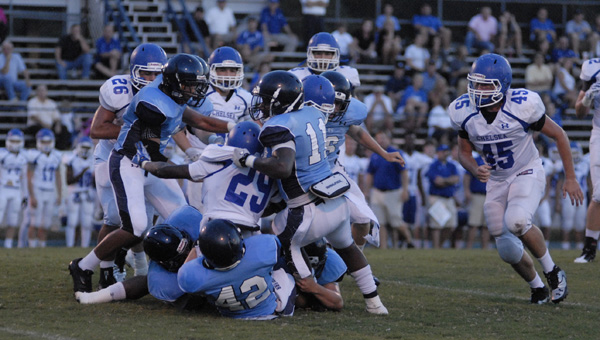 Chelsea running back Austin Washington (29) is tckled by a host of Calera defenders in a preseason matchup Aug. 22. (Reporter Photo/Drew Granthum)