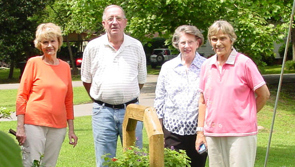 Civitan members Barbara Readal, Hilda Hicks, Don Whitten and Barbara Broadhead pose behind the planter that the Club recently donated to the Montevallo Senior Center. (contributed)