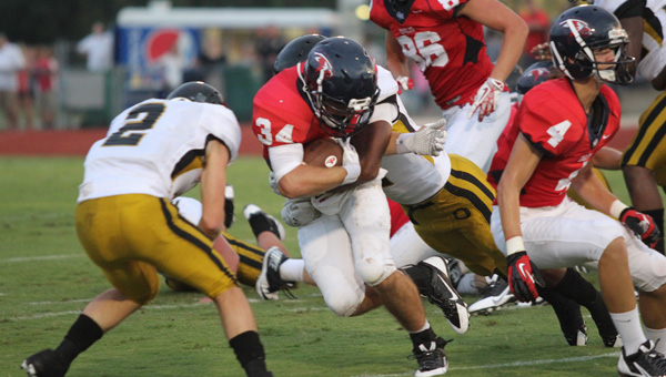 Oak Mountain running back Harold Shader drives over defenders in a jamboree game Aug. 23 against Oxford. (Contributed)