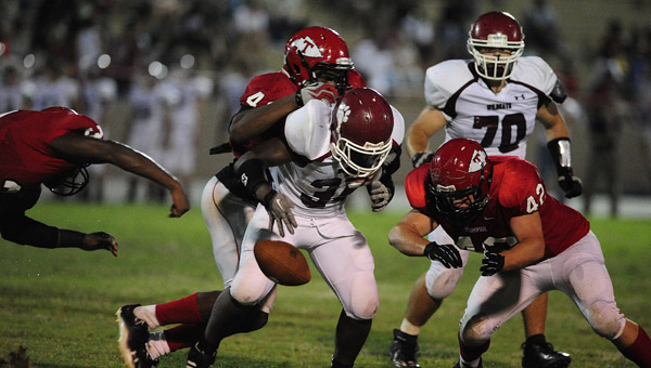 Thompson linebacker Keelan Allman dives for a fumble in an Aug. 30 matchup with Shelby County High. The Warriors shut out the Wildcats, 37-0, to start the season 1-0. (Reporter Photo/Jon Goering)