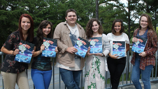 A few PHS Literary Magazine staffers show off their publication including, from left, Hannah Buillion, Sarah Sansom, Casey Brooks, Kaitlin Van Dorsten, Haley Giffin and Maggie Porter. (Contributed)