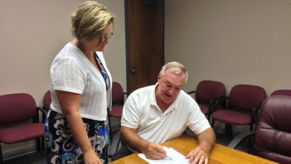 Mayor Stancil Handley works with CASA Board Member Helen Dean to prepare for the upcoming roast. (contributed)