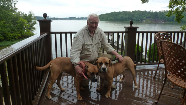 Red Robinson with Honey and Stubbs Robinson, adopted from the Shelby Humane Society, at their home on Lay Lake. (contributed)