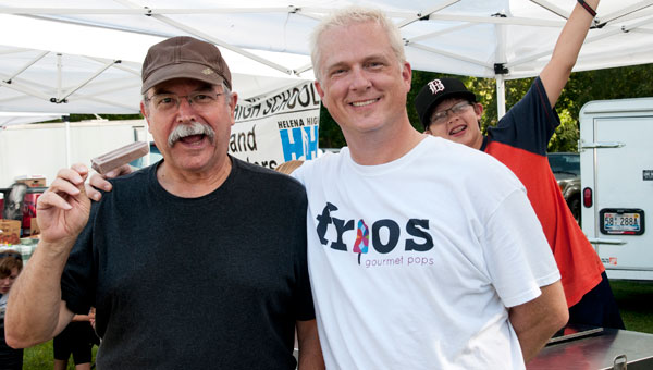 From left are Charlie Holliday, a market regular, who was ready and willing to enjoy a chocolate Frio's Gourmet Pop, with Michael Weidenbach. (contributed)