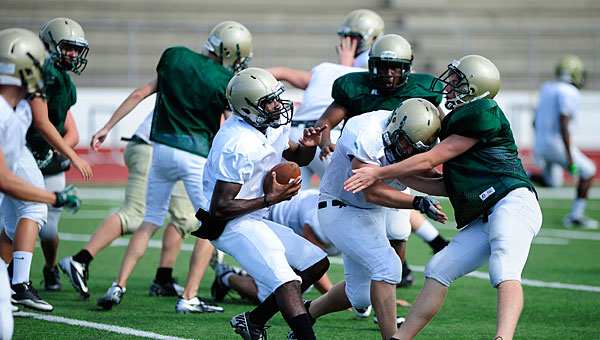 PHS quarterback Devon Mines carries the ball during practice at the school on Aug. 16. (Reporter Photo/Jon Goering)