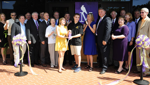 The ribbon is cut on the new Montevallo on Main during a ceremony Aug. 23. (Reporter Photo/Jon Goering)
