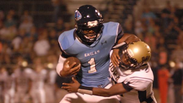 Calera quarterback Ronnie Clark shakes off a Dora defender in a 56-32 win Sept. 6. (Reporter Photo/Drew Granthum)