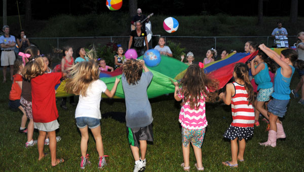 Families enjoyed the Helena Elementary School Welcome Back to School Picnic with entertainment by musician Roger Day. (contributed)