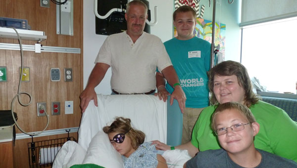 Mollie surrounded by her family at Children's Hospital after surgery to remove a malignant tumor on her brain stem: Father Scott; brother Stephen (SCHS senior), mother Renee', brother Austin (Columbiana Middle School 8th grader). (contributed)