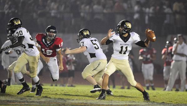 Oak Mountain's Allen Perkins tries unsuccessfully to get to Wetumpka quarterback Christian Montague in a Sept. 5 matchup. (Reporter Photo/Jon Goering)