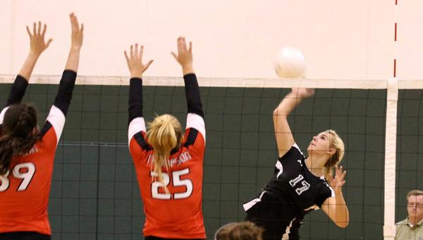 Pelham's Autumn Hiett returns a shot over Thompson's Tara Miller (25) in a 3-1 win Sept. 12. (Contributed/Angeline Jackson)