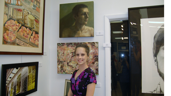 """Hoover-based artist Larisa Brechun, won Best of Show for her portrait """"Shadows,"""" pictured here. (Reporter Photo/Stephanie Brumfield)"""