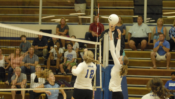 Chelsea's Sarah Quick goes up for a block in a Sept. 10 matchup against Spain Park. (Reporter Photo/Drew Granthum)