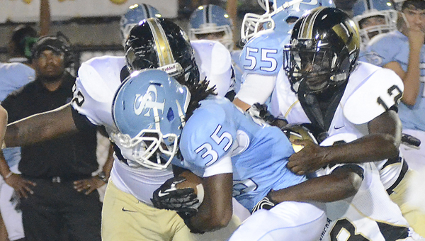 Spain Park's DeAndre Thompkins tries to break free of a tackle in a Sept. 10 matchup with Wetumpka. (Wetumpka Herald/Kevin Taylor)
