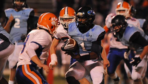 Calera's Ronnie Clark evades tacklers in a 2012 matchup with Chilton County High. The Eagles were named to the No. 1 ranking for the first time since 1982 on Sept. 4. (FILE)