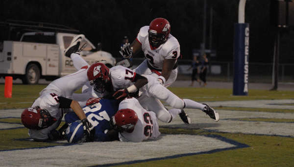 Thompson defenders Kyle Sample (22), Marcus Lewis (3), Terrell Manzano (17) and Jake Rakestraw (55) wrap up Chelsea running back Aki Coles for a safety in a Sept. 5 matchup. (Reporter Photo/Drew Granthum)