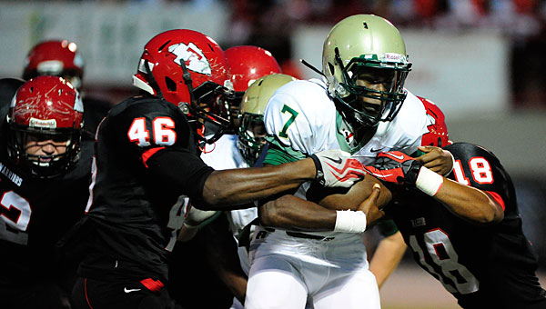 Pelham's Devon Mines gets swarmed by a gang of tacklers from Thompson during Friday's game in Alabaster. (Reporter Photo/Jon Goering)