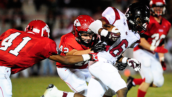 Thompson defenders Derrick Shaw (41) and Keelan Allman (42) team up for tackle during Friday night's game. (Reporter Photo/Jon Goering)