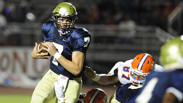 Briarwood's Walker Lott eludes a Chilton County defender in a 22-0 win over the Tigers Oct. 11 (Reporter Photo/Jon Goering)