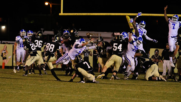 Chelsea's Taylor Martindale reaches out to block a field goal in a 48-45 loss to Wetumpka Oct. 11. The game went into three overtimes. (Contributed/Cari Dean)