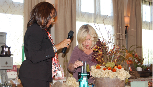 Greystone Ladies Club president Mechelle Wilder, left, helps Shelayne Thompson (Reporter Photo/Stephanie Brumfield)