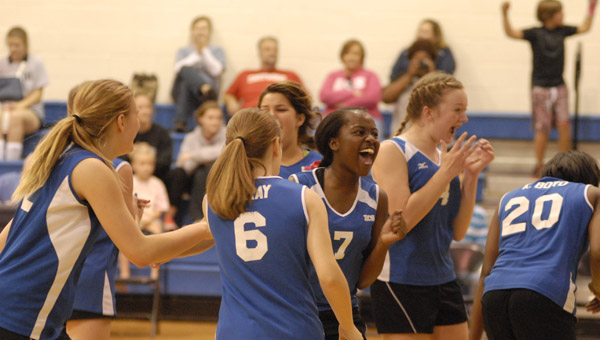 Members of Kingwood Christian's JV volleyball squad celebrate after capturing the AISA JV State Championship in Alabaster Oct. 12. (Reporter Photo/Drew Granthum)