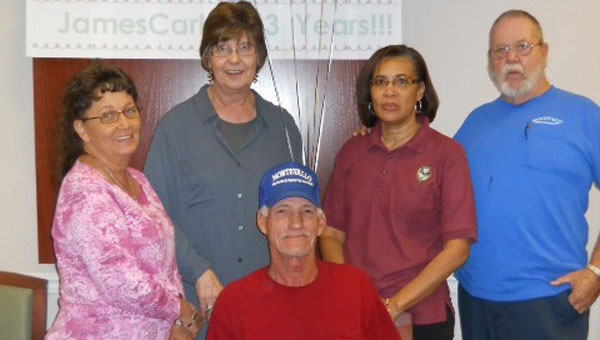 Fellow employees Lavonda Payton, Judy Hammett, Shirley Dubose and Cliff Lawley surround James Carlee at his retirement party. (Contributed)