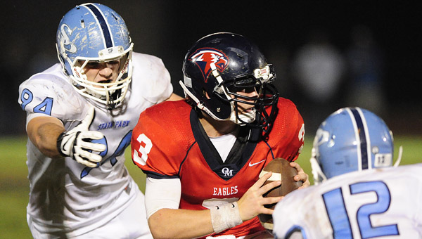 Oak Mountain quarterback Harold Shader tries to avoid a tackle in a Oct. 11 matchup with Spain Park. (Reporter Photo/Jon Goering)
