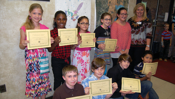 From back left: Montevallo elementary students Anna Bright, Kayce Sankey, Jennifer Garsia, Kali Yancey, Janie Gray, Montevallo Elementary principal Allison Campbell, Caleb Johnson, Campbell Cost, Justin E. Hyde and Nathan Moore were recognized at the Oct. 14 Montevallo City Council meeting for scoring in the top 2 percent on the Alabama Read and Math Test. (Reporter Photo/Stephanie Brumfield)