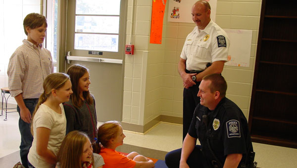 School Officer Brandon Pendergrass, kneeling, and Police Chief Jeremy Littleton talk with Montevallo Elementary School Student Government leaders: Anna Kate Church, Chloe Boyd, Hayden Dennis, Emily Carter and Matt Macomb. (contributed)