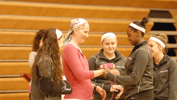 The Thompson Warriors volleyball squad made Andrea Thames an honorary coach for an Oct. 9 match against Stanhope Elmore that promoted Breast Cancer Awareness. (Reporter Photo/Drew Granthum)