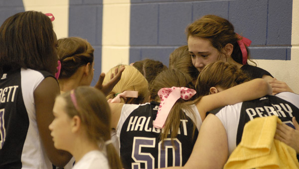 Members of Cornestone Christian's volleyball squad huddle up after falling to Bessemer Academy in the finals of the AISA volleyball championship Oct. 24. (Reporter Photo/Drew Granthum)