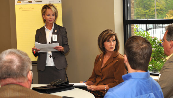Sondra Dunaway, leader of Alabama Power Company Economic & Community Development team and city council president Cris Nelson during one of the small focus groups. (contributed)