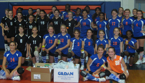 The picture: Riverchase Middle and Montevallo Middle School volleyball teams work together in collecting canned goods for Shelby Emergency Assistance. (contributed)