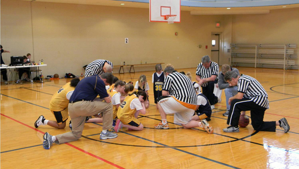 Upward Sports, the world's largest Christian youth sports league, partners with more than 2,500 churches worldwide. Here, basketball players at First Baptist Church of Alabaster say a prayer before a game. (Contributed)