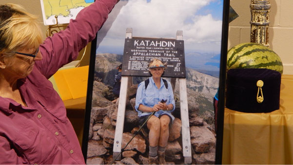Olean Kenny sits atop Mount Katahidin in Maine, the end of the Appalachian Trail, in a picture taken by fellow-hiker Dale South and presented to her at a Sept. 29 celebration of her accomplishment. (contributed)