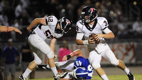 Oak Mountain quarterback Warren Shader looks for room to run in a 31-21 win over Chelsea Oct. 4.