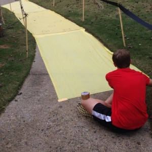 Talbert puts the final touches on the yellow brick road on Oct. 30. (Contributed)