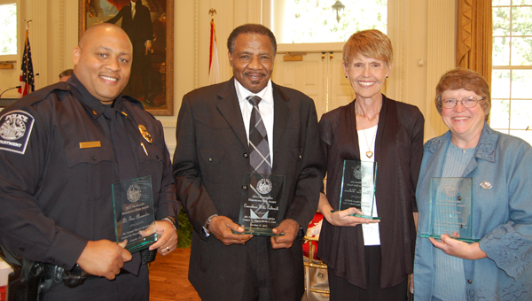 From left, Lt. Tim Alexander, Montevallo city council member Willie Goldsmith, former Montevallo Chamber of Commerce executive director Mary Lou Williams and Boys and Girls Club of Montevallo executive director Freda Shivers. (Reporter Photo/Stephanie Brumfield)