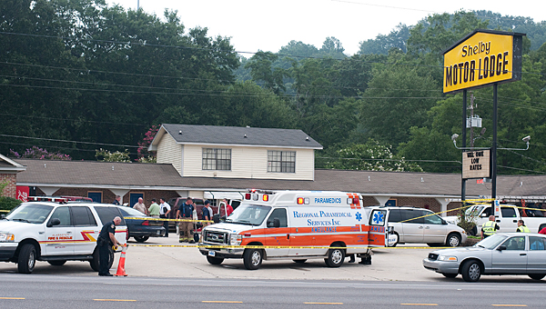 Alabaster police investigate the scene of a fatal 2011 stabbing at the Shelby Motor Lodge in Alabaster. The man arrested for the crime will spend the rest of his life in prison. (File)