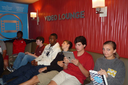 Spain Park students enjoy the Bookmobile's Video Lounge. (Reporter photo/Amy Jones)