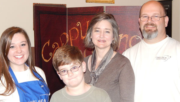 Rhonda and Jeff Gross, pictured with their children, Jacob and Heather, serve the Chelsea community with great food and drink, along with a great place for individuals and groups to meet for business and fun.  (contributed)