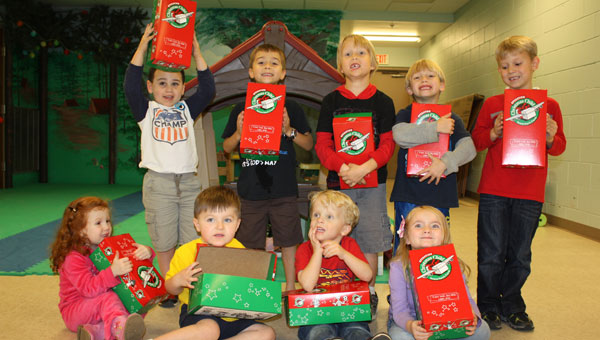 Preschoolers at First Baptist Church of Columbiana help pack Operation Christmas Child shoeboxes. Front Row, from left, Rudy Poe, Kellen Houston, Colin Endfinger and Abigail Moss. Back row, from left, David Powell, Jonathan Ludwig, Caleb Endfinger, Sam Poe and Drew Shelton. (Contributed)