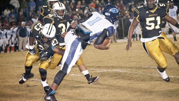 Calera QB Ronnie Clark (1) escapes the grasp of Dadeville's Tre Marbury during the Eagles' second-round match-up against the Tigers. (Robert Hudson/Alexander City Outlook)